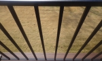 Our black aluminum handrails do not disrupt the view