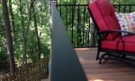 The aluminum handrail system Durante installed has a thin frame design so it won\'t disrupt the pretty view looking off the deck.