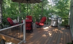 Customer\'s back deck is surrounded by nature and needed a deck that would blend in. Durante delivered as promised.