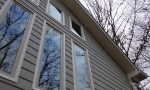 This end of the home has numerous large windows thay received a lot of direct sunlight
