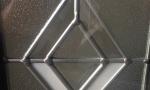 Decorative glass still lets some light in without jeopardizing privacy.