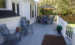 The new deck overlooks the gorgeous backyard.