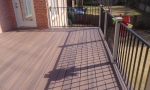 Maintenance free composite decking with aluminum handrails.